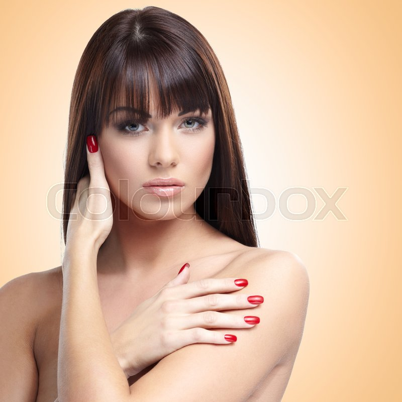 Stock image of 'Portrait of beautiful female model on nude background'