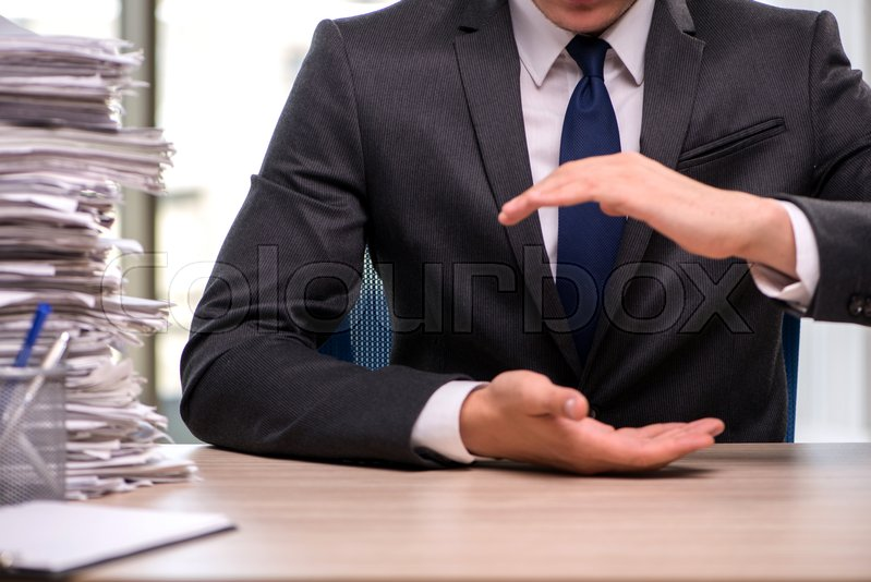 Stock image of 'Businessman holding hands in business concept'