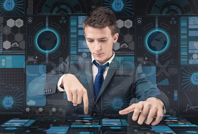 Stock image of 'Young man in data management concept'
