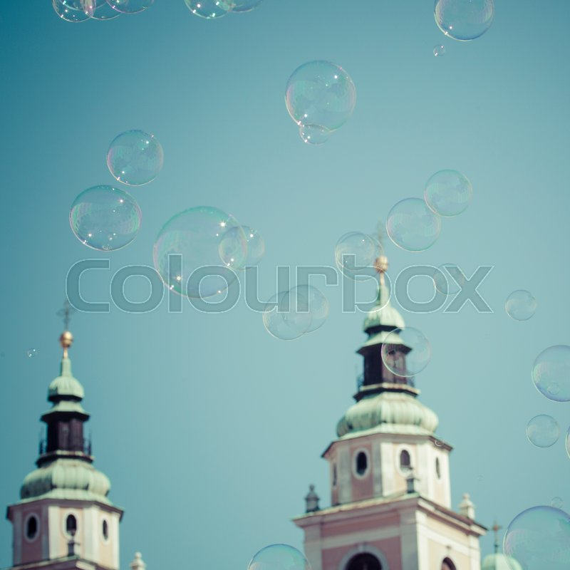 Editorial image of 'LJUBLJANA  - SLOVENIA - SEPTEMBER 25, 2016 : St. Nicholas Cathedral  in Ljubljana, Slovenia. The Slovenian capital city has a nice medievalold city with churches.Many soap bubbles.'