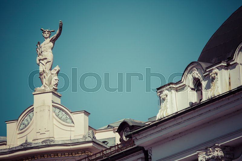 Editorial image of 'LJUBLJANA, SLOVENIA - SEPTEMBER 24, 2016: Mercury, the Roman God, at the top of the Galeria Emporium, former Mercure Center (1903), Ljubljana, Slovenia'