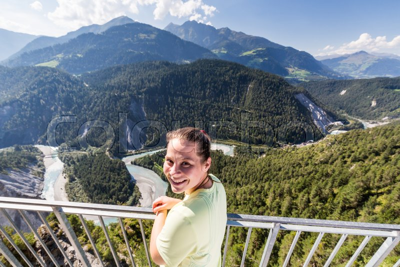 Stock image of 'View of a Girl on the outlook viewpoint Il Spir at the Rhine Valley, Flims, Switzerland'