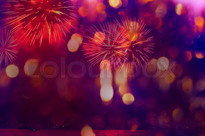 Stock image of 'A collage of exploding fireworks in the night. Decorated with light spots. Good for holiday background.'