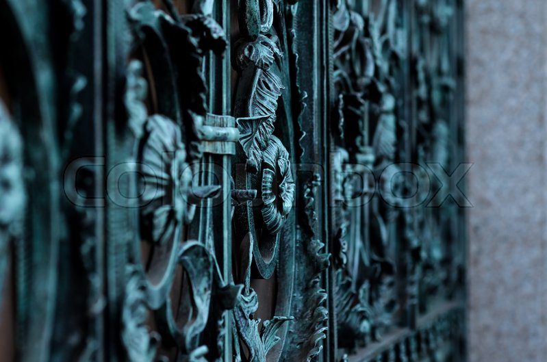 Stock image of 'vintage blue wrought iron gate in oxidized patina'