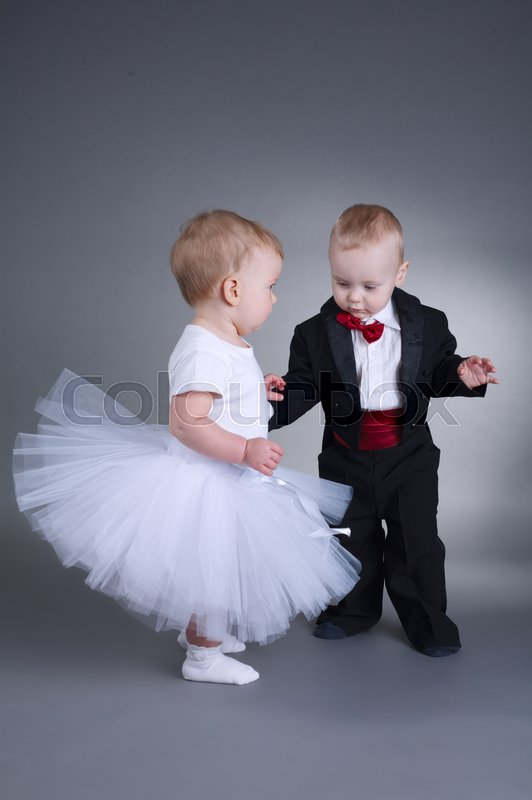 photo of cute boy and girl in wedding dress stock photo colourbox