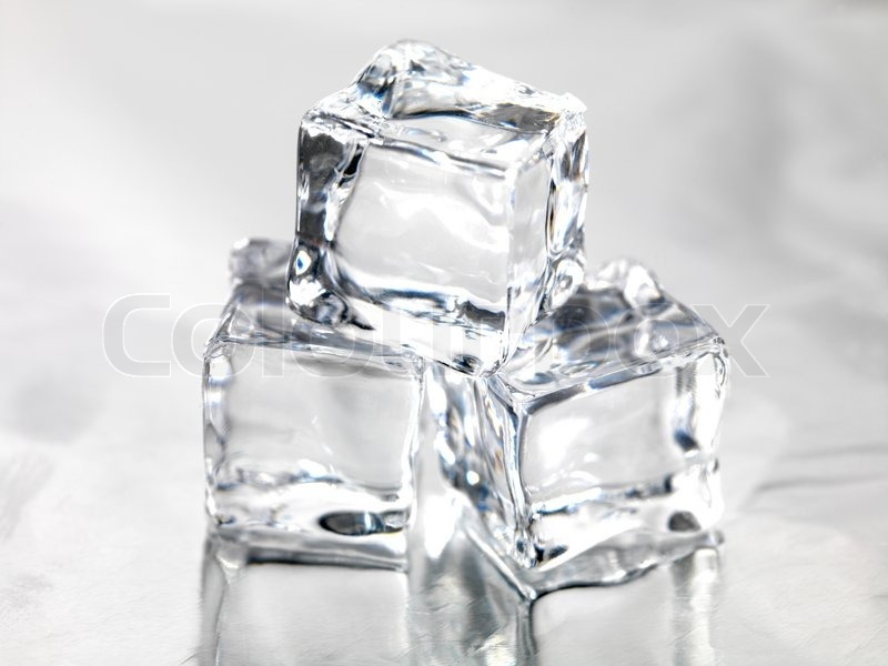 Frozen Ice Cubes Isolated On A Kitchen Bench Stock Photo