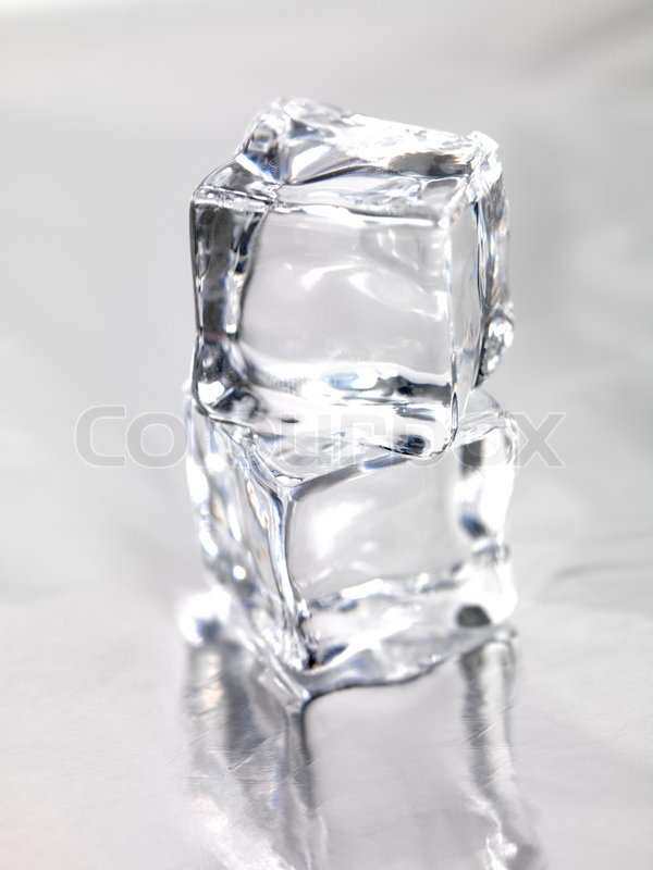 Frozen ice cubes isolated on a kitchen bench | Stock Photo ...