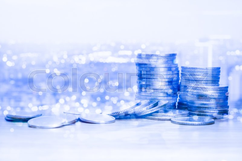 Stock image of 'Double exposure of coins and city for business finance concept.'