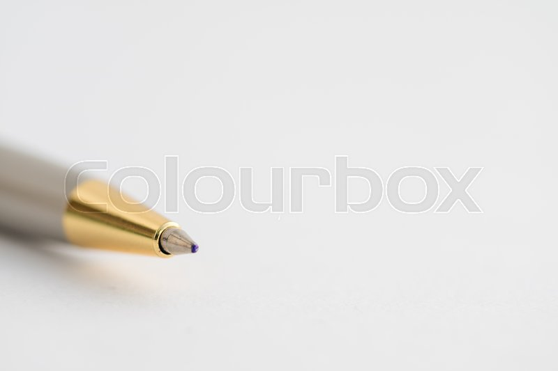 Stock image of 'A pen on white paper.'