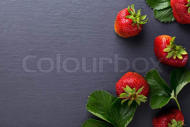 Stock image of 'red ripe strawberry on a black background'