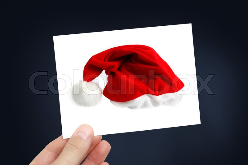 Stock image of 'Christmas hat on a white card'