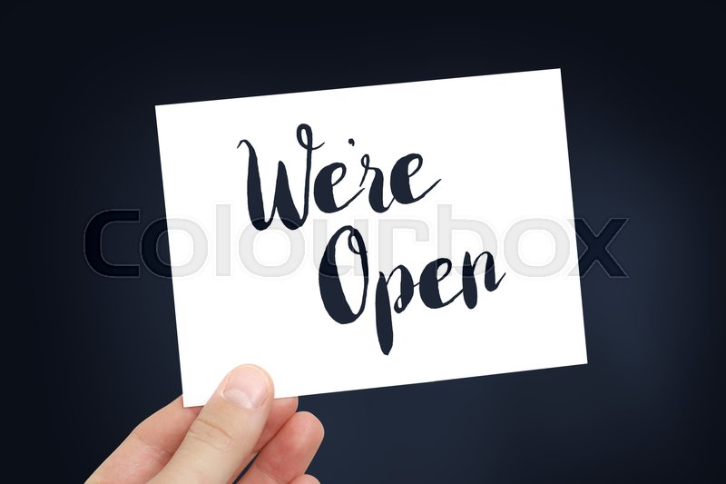 Stock image of 'We're open written on a white card'