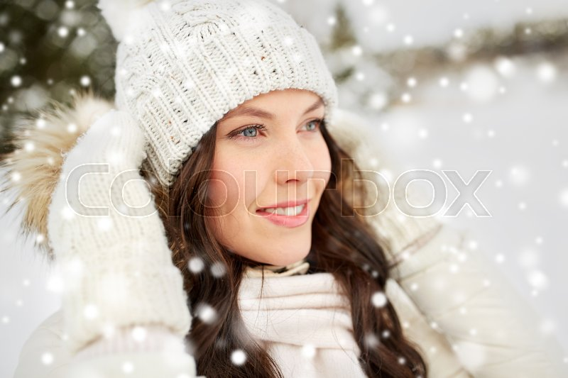 Stock image of 'people, season and leisure concept - happy woman outdoors in winter'