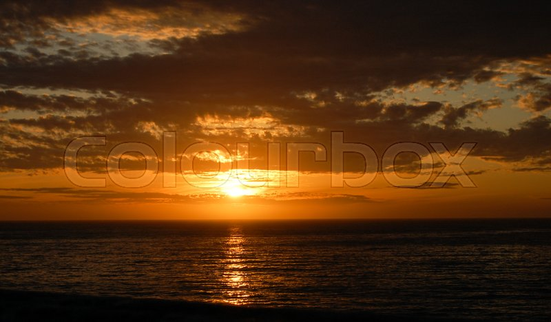 Stock image of 'A beautiful sunset at California,with some clouds'
