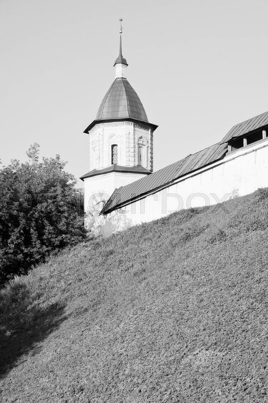 Stock image of 'Tower of an ancient monastery on the top of the hill black and white'