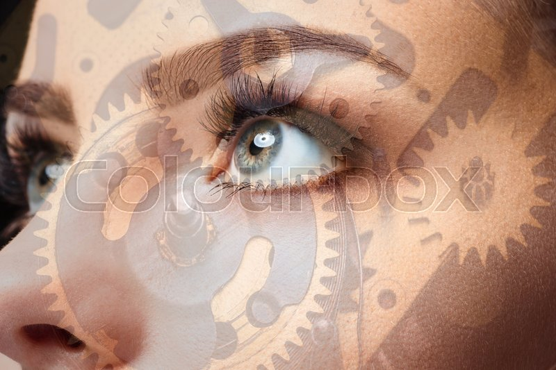 Stock image of 'Photo of woman eye and clockwork. The double exposure'