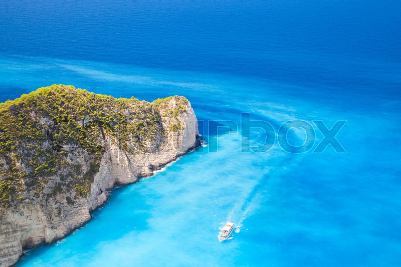 Stock image of 'Touristic motor boat goes on Navagio Bay to the Ship Wreck beach. The most famous nature landmark of Greek island Zakynthos in the Ionian Sea'