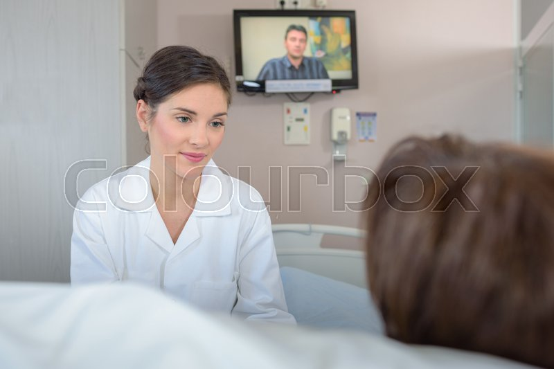 Stock image of 'Patient watching tv in hospital'