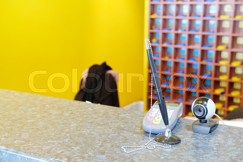 Stock image of 'The image of a plastic card reader on a reception table'