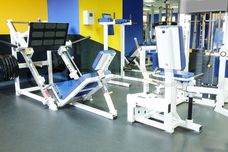 Stock image of 'Interior of a fitness hall with sport equipment'