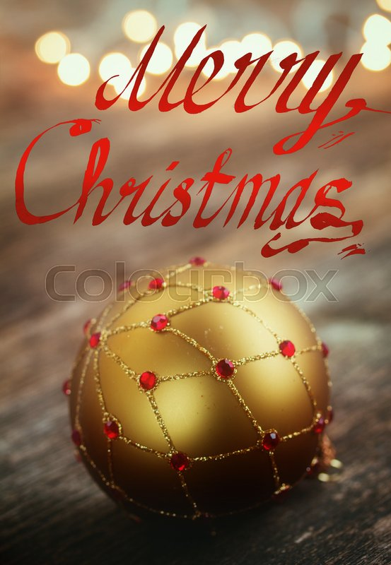 Merry Christmas letters and golden ball , christmas lights in background, retro toned, stock photo