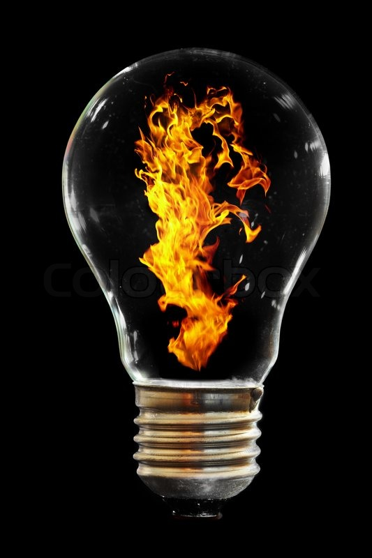Light Bulb With Fire On The Black Stock Photo Colourbox