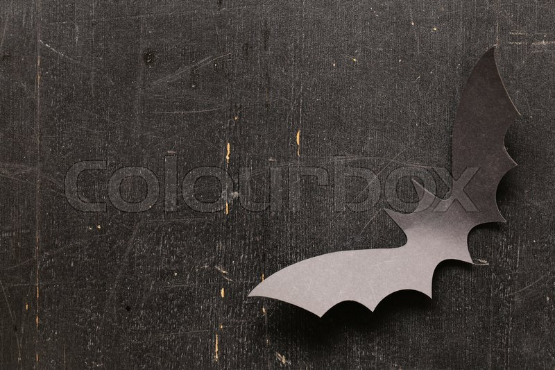 Stock image of 'Paper origami bats on a wooden background, decorations for the holiday Halloween'