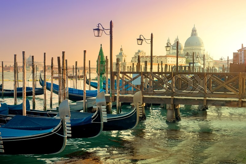Stock image of 'Gondolas and basilica Santa Maria della Salute in Venice, Italy'