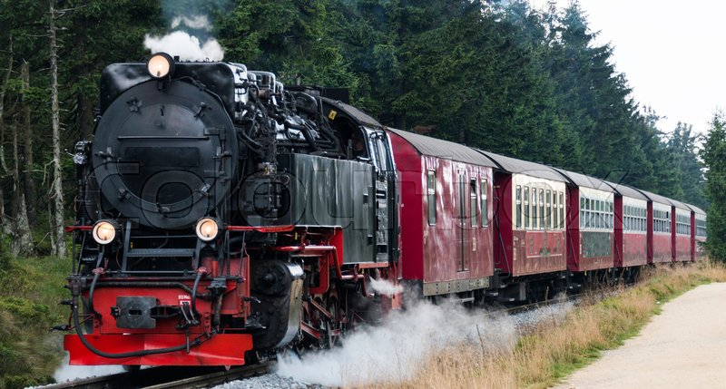 Stock image of 'Narrow gauge steam engine from Brocken to Werningerode. The trains to the Brocken mountain are popular with tourists and operate around the year.'