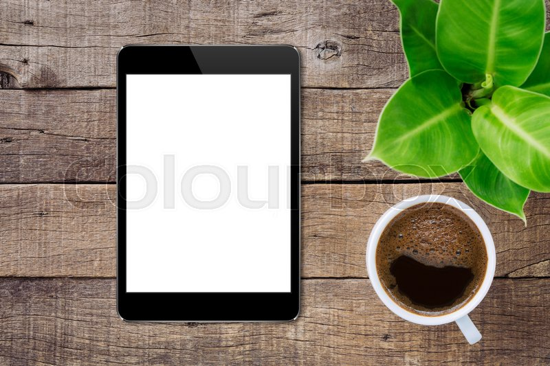 Stock image of 'Digital tablet on wood table top view, tablet white screen for adjust app screen'