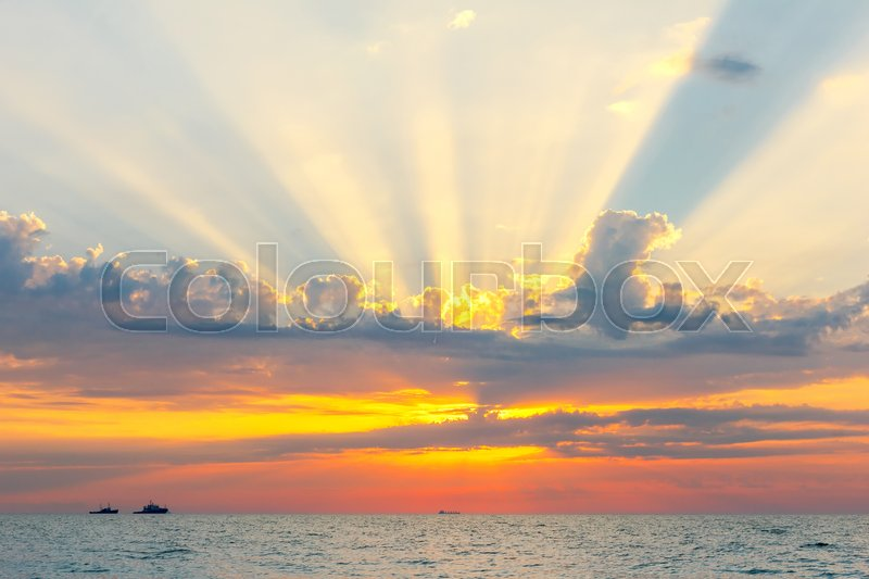 Stock image of 'Picturesque views of the outgoing to the horizon the sun and the ships at sea.'