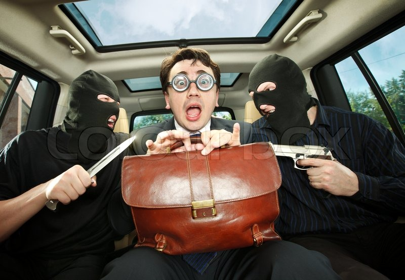 Stock image of 'Robbery, businessman grasped in hostages.'