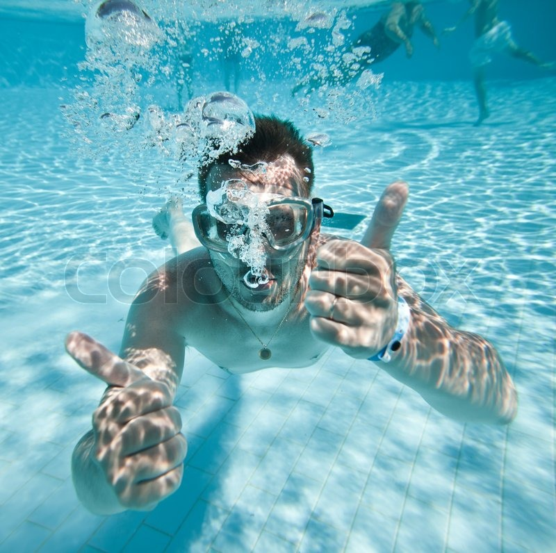 Man Floats Underwater In Pool Stock Photo Colourbox