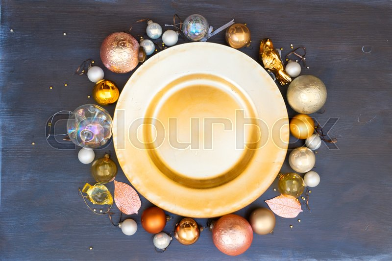Stock image of 'Christmas empty golden plate with gold decorations frame'