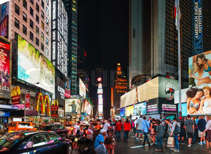 Stock image of 'NEW YORK CITY - SEPTEMBER 05: Times square with people in the night on October 5, 2015 in New York City. It's major commercial intersection and neighborhood in Midtown Manhattan at the junction of Broadway and 7th Avenue.'