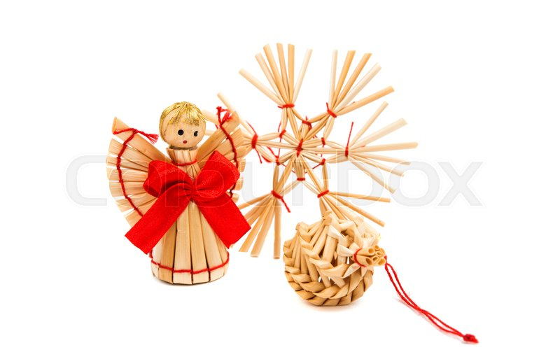 Stock image of 'straw Christmas decorations on a white background'