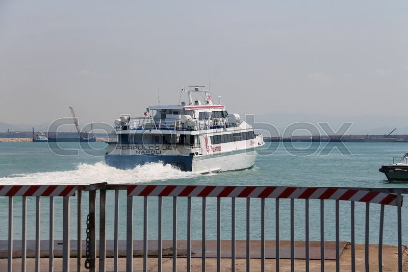Editorial image of 'Piombino, Italy - June 30, 2015: Ferry boat Acapulco Jet departs from the pier'