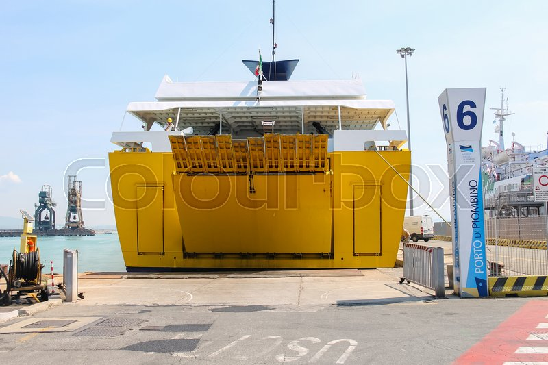 Editorial image of 'Piombino, Italy - June 30, 2015: Ferry boat Corsica Express opens its cargo hold at berth of seaport'