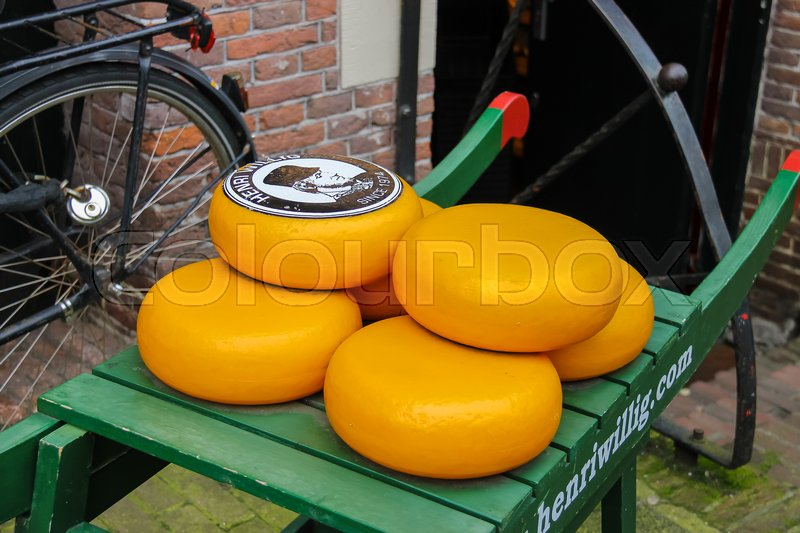Editorial image of 'Amsterdam, the Netherlands - October 03, 2015: Dutch cheese on traditional wooden barrow in city centre'