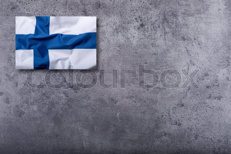 Stock image of 'Flags of the Finland on concrete background.'