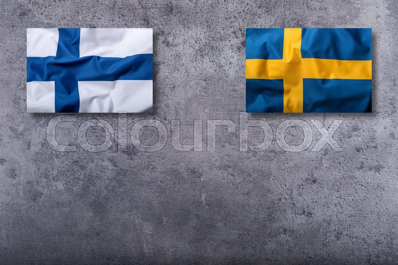 Stock image of 'Flags of the finland and sweden on concrete background.'