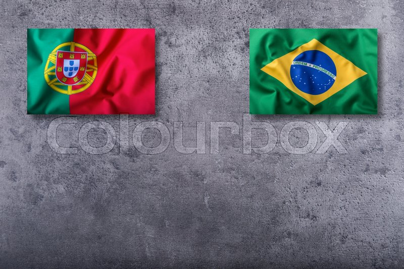 Stock image of 'Flags of the portugal and brazil on concrete background.'
