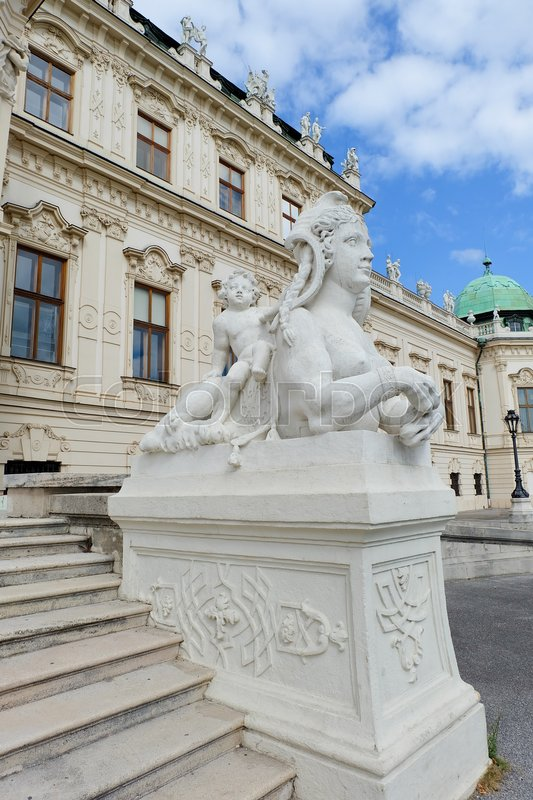 Stock image of 'Vertical view of part of Upper Belvedere in Vienna in Austria with staircase and statue of sphinx and boy'
