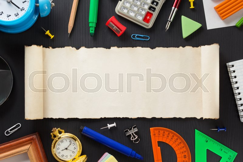 Stock image of 'school supplies on black wooden background'