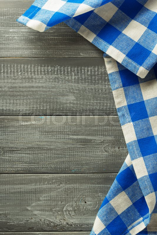 Stock image of 'cloth napkin on wooden background'