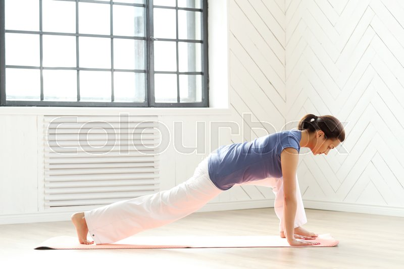 Stock image of 'Fitness. Woman during pilates workout'