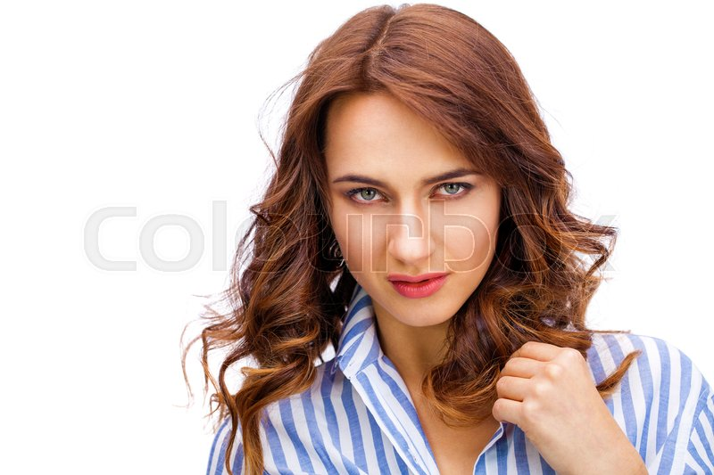 Stock image of 'Happy brunette woman in a striped blue shirt, isolated on white background'