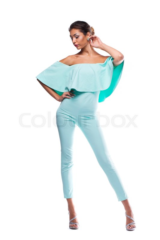 Stock image of 'Portrait in full growth of a beautiful young woman in turquoise tight clothes, isolated on white background'