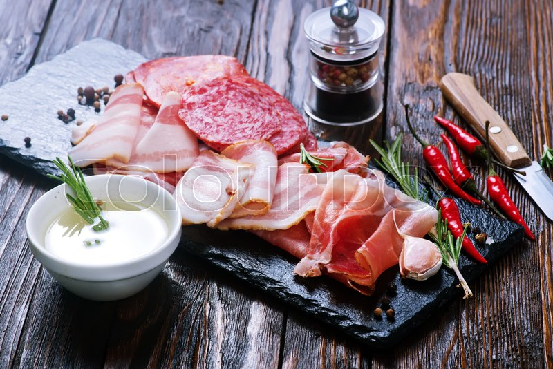 Stock image of 'Delicious and tasty meat dishes on the board'