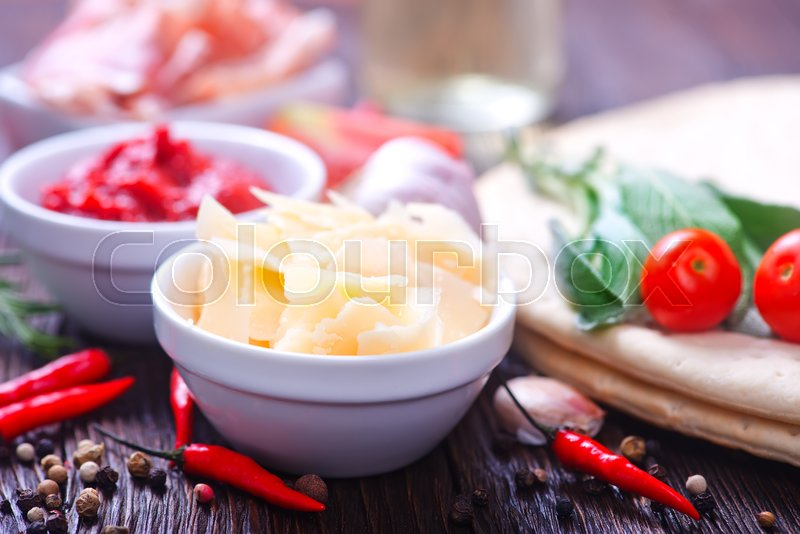 Stock image of 'ingredients for pizza on the wooden table'